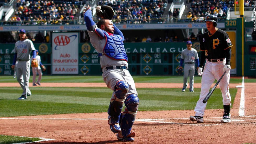 Welington Castillo of the Chicago Cubs makes a catch in foul territory during the game against the Pittsburgh Pirates on April 1 in Pittsburgh. The Cubs won 3-1.