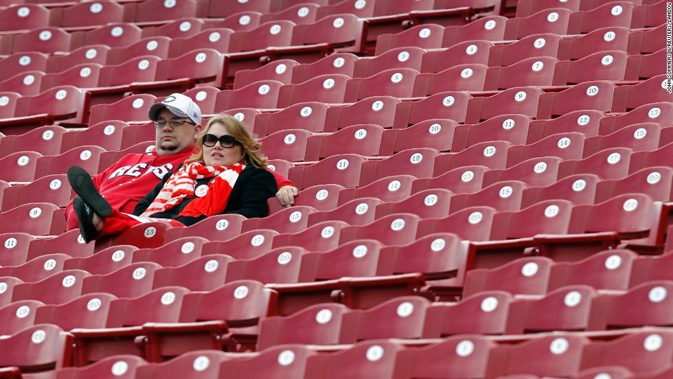 Cincinnati Reds fans watch their team practice before their game against the Los Angeles Angels of Anaheim in Cincinnati.