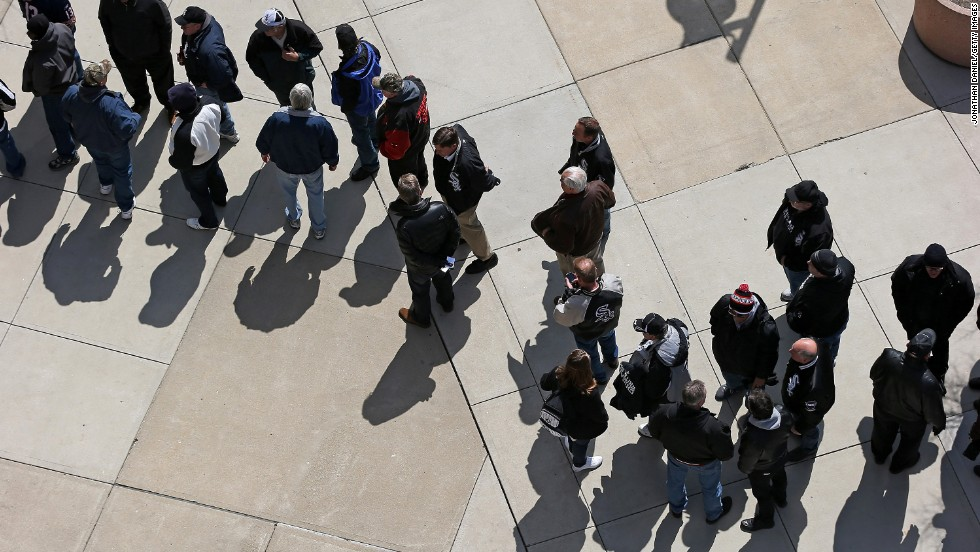 Fans wait to enter U.S. Cellular Field in Chicago for the White Sox's game against the Royals.