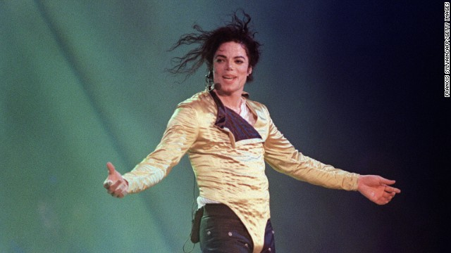 "US pop star and entertainer Michael Jackson preforms before an estimated audience of 60,000 in Brunei on July 16, 1996. Michael Jackson died on June 25, 2009 after suffering a cardiac arrest, sending shockwaves sweeping across the world and tributes pouring in on June 26 for the tortured music icon revered as the ""King of Pop."""