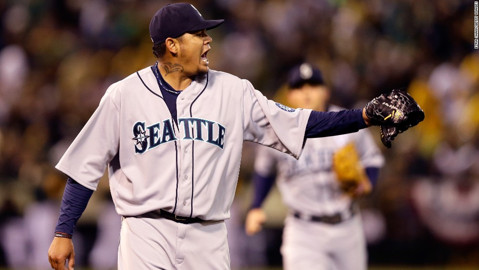 Seattle Mariners pitcher Felix Hernandez reacts after shortstop Brendan Ryan throws out Yoenis Cespedes of the Oakland Athletics to end the fourth inning on Monday, April 1, in Oakland, California. The Mariners won 2-0 on Opening Day, the official start of the 2013 Major League Baseball season.