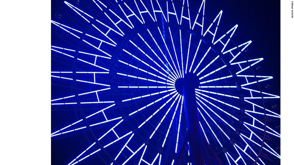 The big Ferris wheel in the Harborland in Kobe, Japan, lights up in 2012 for World Autism Awareness Day.