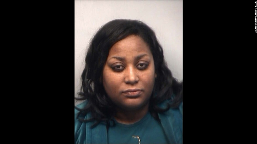 Tameka Goodson, a former school improvement specialist at Kennedy Middle School, was the first defendant to turn herself in.