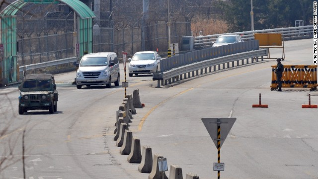 """A South Korean military vehicle (L) leads cars arriving from the Kaesong joint industrial park in North Korea, at a military check point of the inter-Korean transit office in Paju on April 3, 2013 after being refused access to the Seoul-funded Kaesong complex . North Korea blocked South Korean access to a key joint industrial zone on April 3, in a sharp escalation of tensions as Washington condemned Pyongyang's """"dangerous, reckless"""" behaviour. AFP PHOTO / JUNG YEON-JE        (Photo credit should read JUNG YEON-JE/AFP/Getty Images)"""