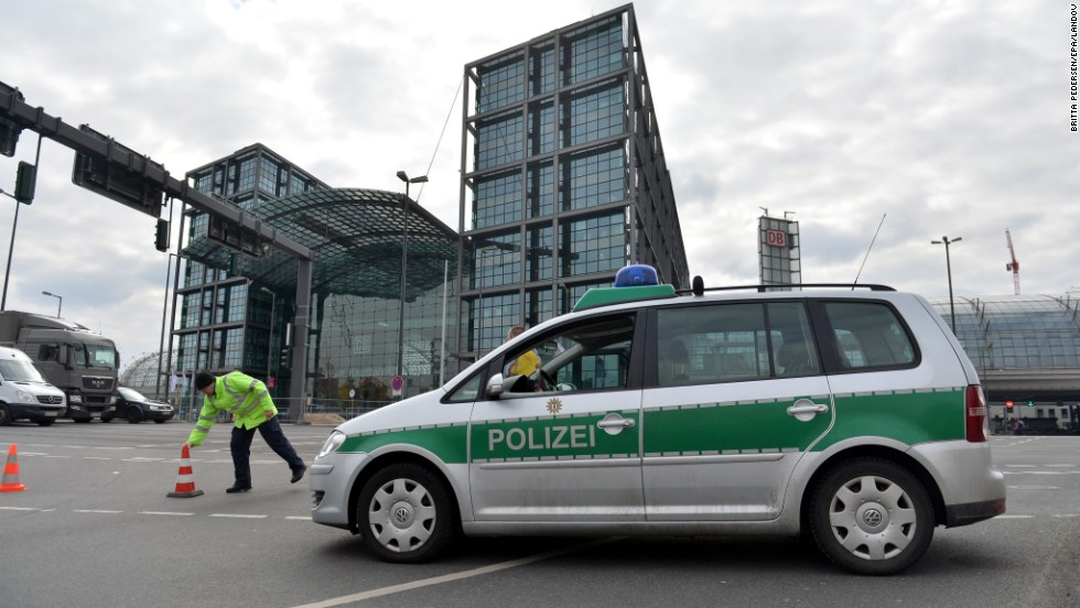 A police officer closes off the entrance to the Hauptbahnhof, the central rail station, on April 3. A bomb disposal team checking out a construction site near the station discovered the bomb, and roads were closed overnight.