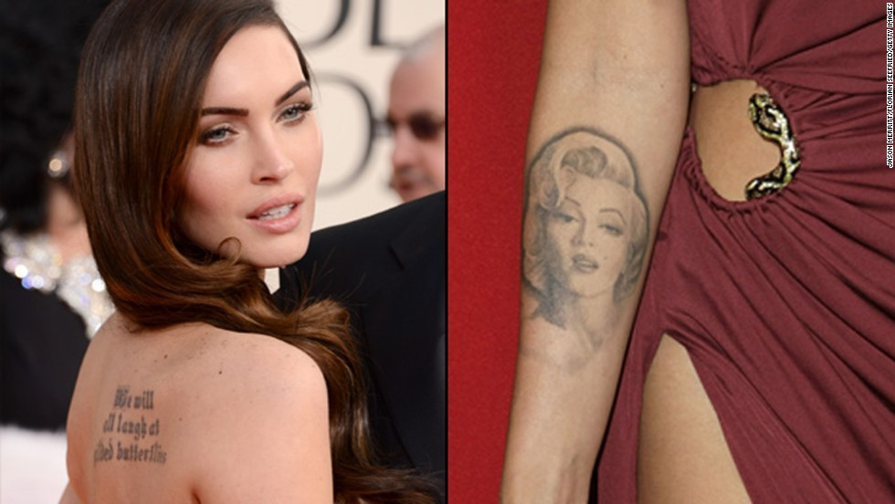 "Megan Fox has two prominent tattoos. Shakespeare's ""We will all laugh at gilded butterflies"" is inked on her back, and <a href=""http://www.usmagazine.com/celebrity-news/news/megan-fox-removing-marilyn-monroe-tattoo-has-been-traumatic-2012282"" target=""_blank"">she used to sport a picture of Marilyn Monroe on her forearm. </a>"
