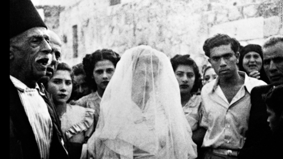 """Samira in her wedding gown, the first Christian Palestinian wedding in Lod after 1948,"" by Dor Guez. Guez's work makes use of scanned archival images, which he calls ""scanograms,"" to tell the story of the Palestinian Christian community."