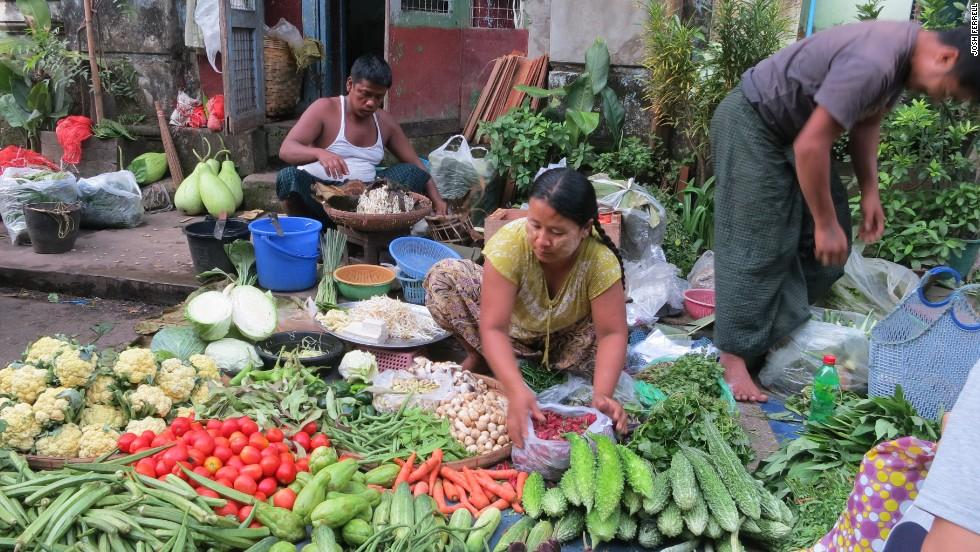 Vendors hawk vibrant produce at open-air markets.