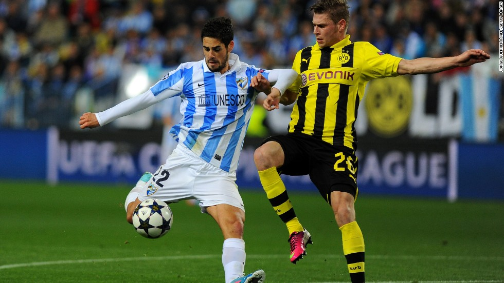 Dortmund's Lukasz Piszczek had his hands full up against Malaga's talented midfielder Isco in a hard-fought affair in Spain. Malaga, which is playing in the competition for the first time in its history, was given a rough ride by the German side.