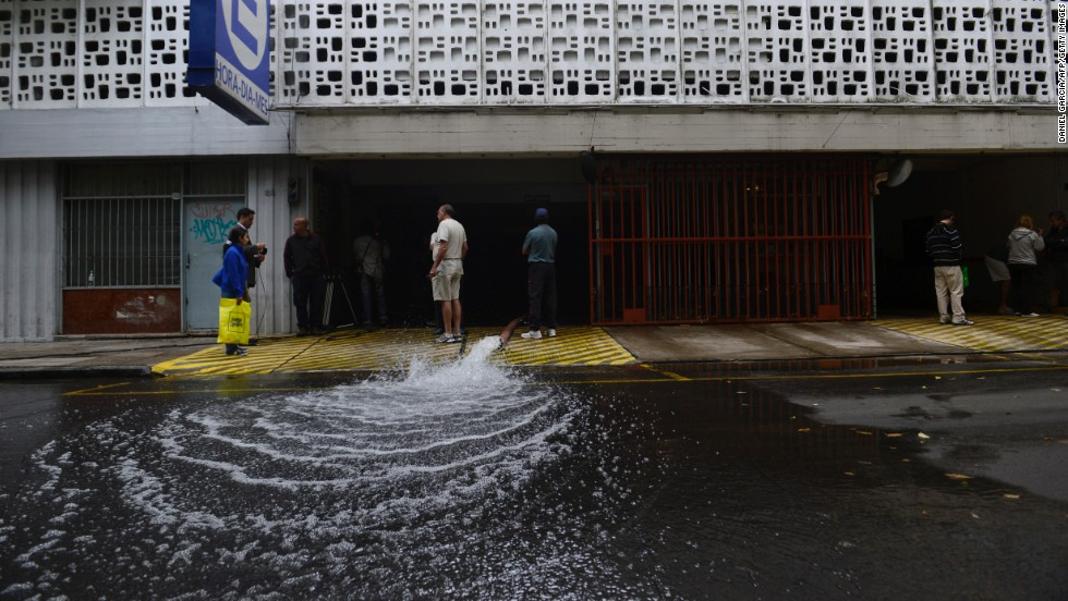Workers pump water out of a flooded parking garage on April 3 in the Nunez neighborhood of Buenos Aires.