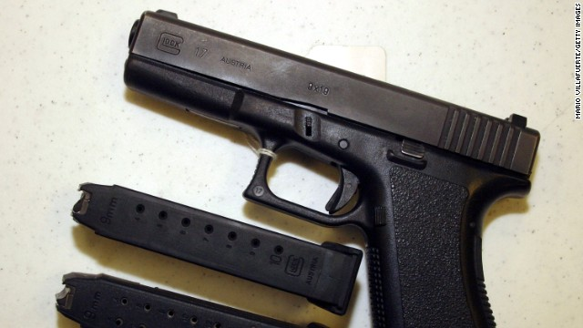 BOSSIER CITY,LA-SEPTEMBER 11: A Glock 9mm pistol, legal to own under present guns laws, is displayed with 2 different capacity bullet clips at Shooters USA target range on September 11, 2004 in Bossier City, Louisiana. The top clip holds a total of 10 bullets currently legal, the bottom clip 18 bullets, is only legal for law enforcement officers. When the Assault Weapons Ban expires at midnight Monday September 13 the 18 round high capacity magazine will be legal to purchase. (Photo by Mario Villafuerte/Getty Images)