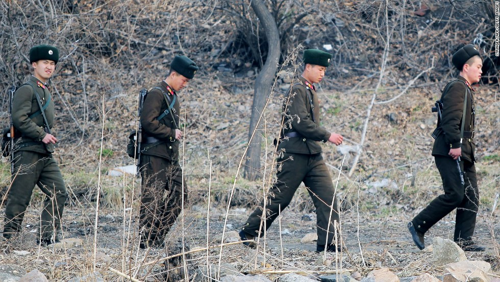 North Korean soldiers patrol near the Yalu River in April 2013.