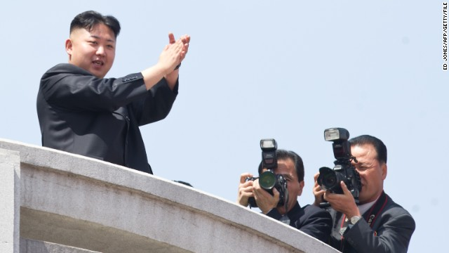 North Korean leader Kim Jong-Un (L) applauds during a military parade in honour of the 100th birthday of the late North Korean leader Kim Il-Sung in Pyongyang on April 15, 2012.