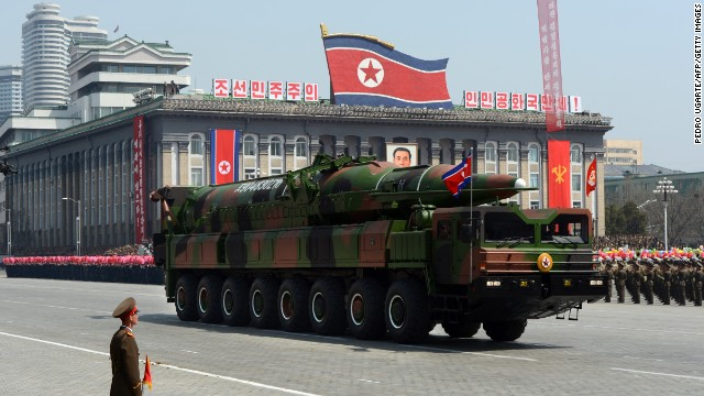 A military vehicle carries what is believed to be a Taepodong-class missile Intermediary Range Ballistic Missile (IRBM), about 20 meters long, during a military parade to mark the 100 birth of the country's founder Kim Il-Sung in Pyongyang on April 15, 2012. The commemorations came just two days after a satellite launch timed to mark the centenary