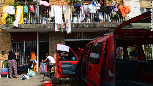 People affected by the storm and resulting floods in La Plata put their clothes and other belongings out in the sun to dry on April 4.