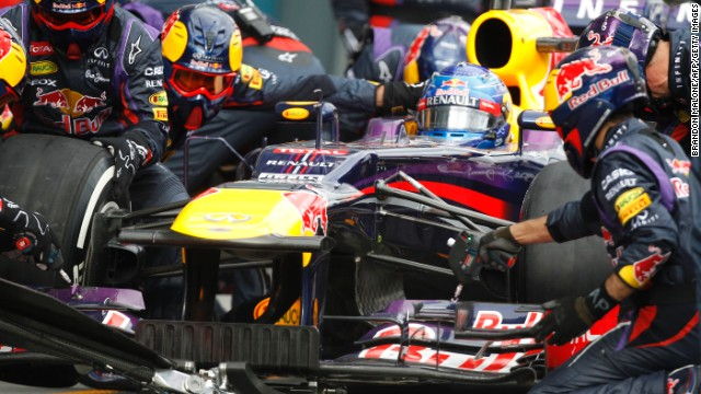 The Red Bull pit crew, pictured here working on Sebastian Vettel's car, set the record in Malaysia.