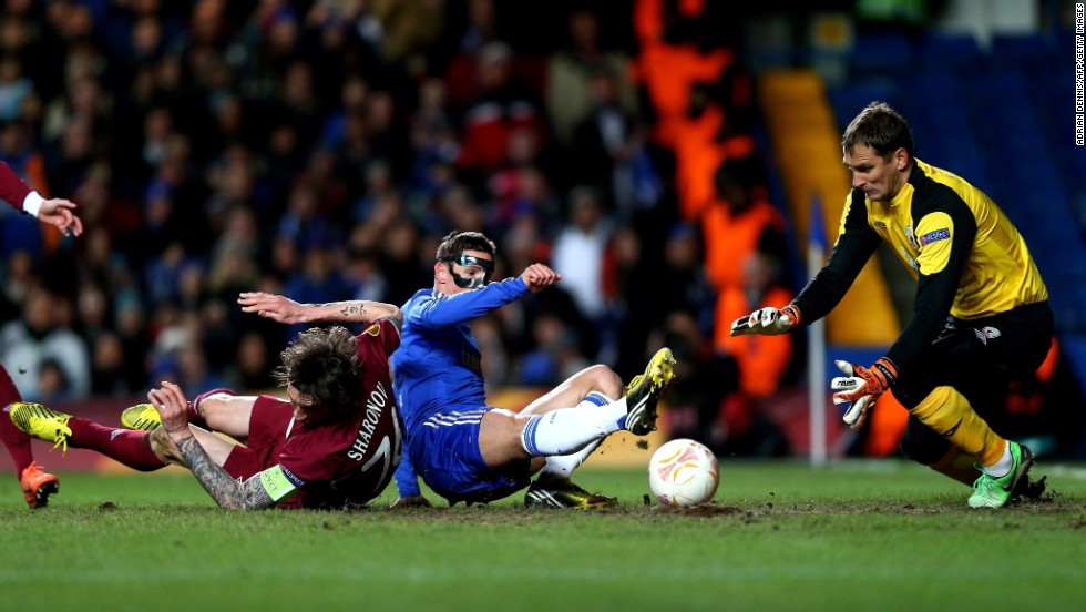 Fernando Torres, wearing his protective mask,  fired Chelsea ahead after 16 minutes against Rubin Kazan as the home side took control of the first leg at Stamford Bridge. Victor Moses then added a second 16 minutes later.