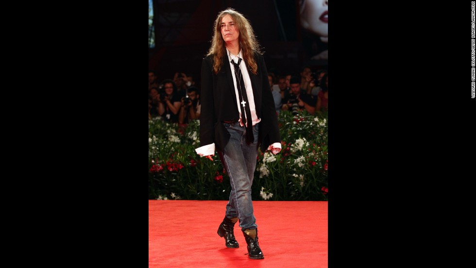 "Musician Patti Smith also belongs to the <a href=""http://www.biography.com/people/patti-smith-9487150?page=1"" target=""_blank"">canon of quintessential tomboys </a>in style and substance. Before breaking into New York's male-dominated punk rock scene in the 1970s and achieving mainstream success with the Patti Smith Group, she held a job in a toy factory, dated photographer Robert Mapplethorpe, published a book of poetry and wrote for Rolling Stone. In addition to her musical chops, she taught a generation that it was possible to exude confidence and glamor in jeans, T-shirts and ties."