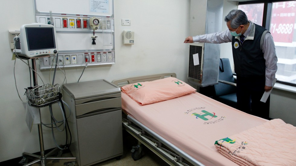 Taiwan's Health Minister Chiu Wen-ta checks the negative pressure system in a isolation room as he inspects preparations for the virus in Taipei City Hospital Heping Branch, on April 6.