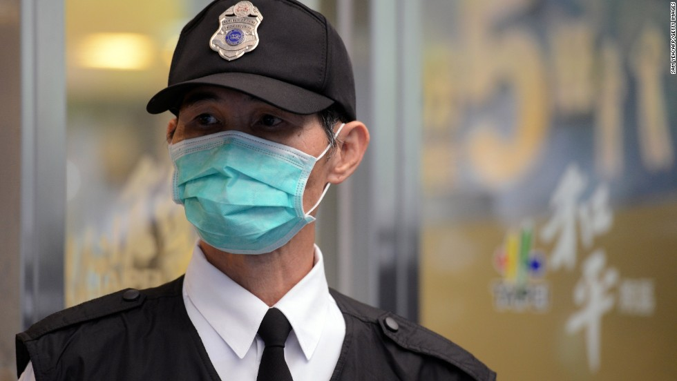 A masked security guard stands outside Taipei Hoping Hospital on April 6, where new isolation units have been set up to treat potential new avian influenza cases.