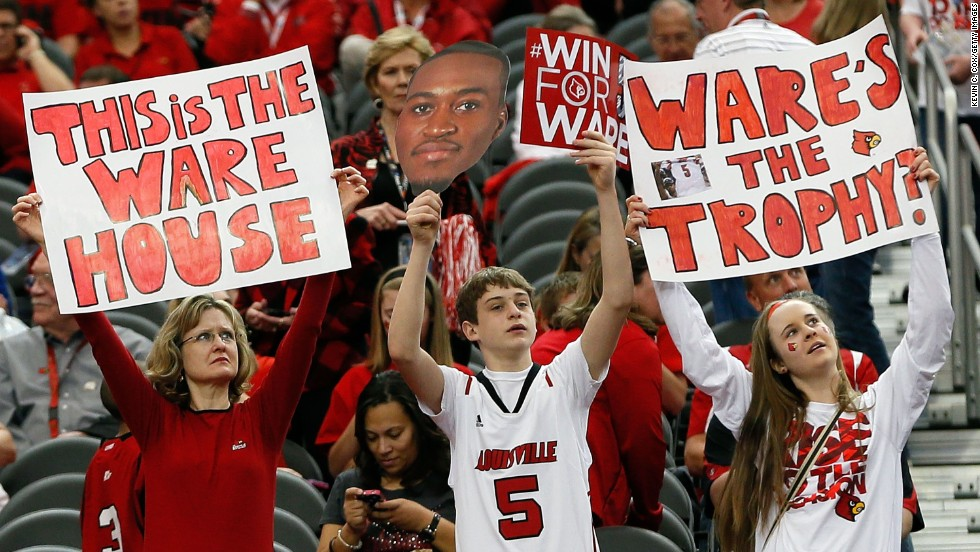 Louisville fans hold up signs for Ware before the game.