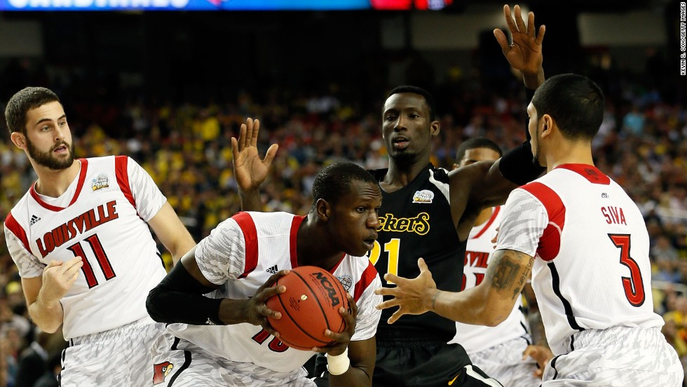 Gorgui Dieng of Louisville controls a rebound against Ehimen Orukpe of Wichita State.