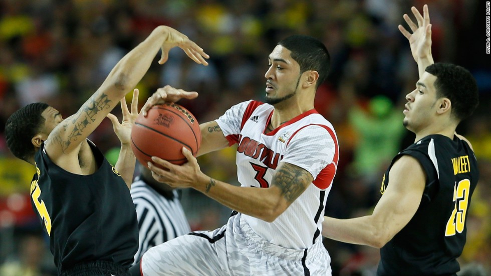 Peyton Siva of Louisville attempts to control the ball between Demetric Williams, left, and Fred VanVleet, right, of Wichita State.