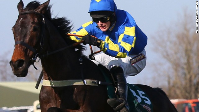 Ryan Mania is pictured riding Auroras Encore at the Grand National steeplechase on Friday in Liverpool, England.