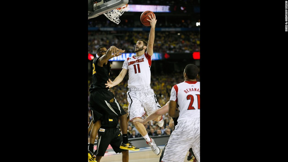 Luke Hancock of Louisville drives for a layup attempt against Wichita State's Carl Hall.