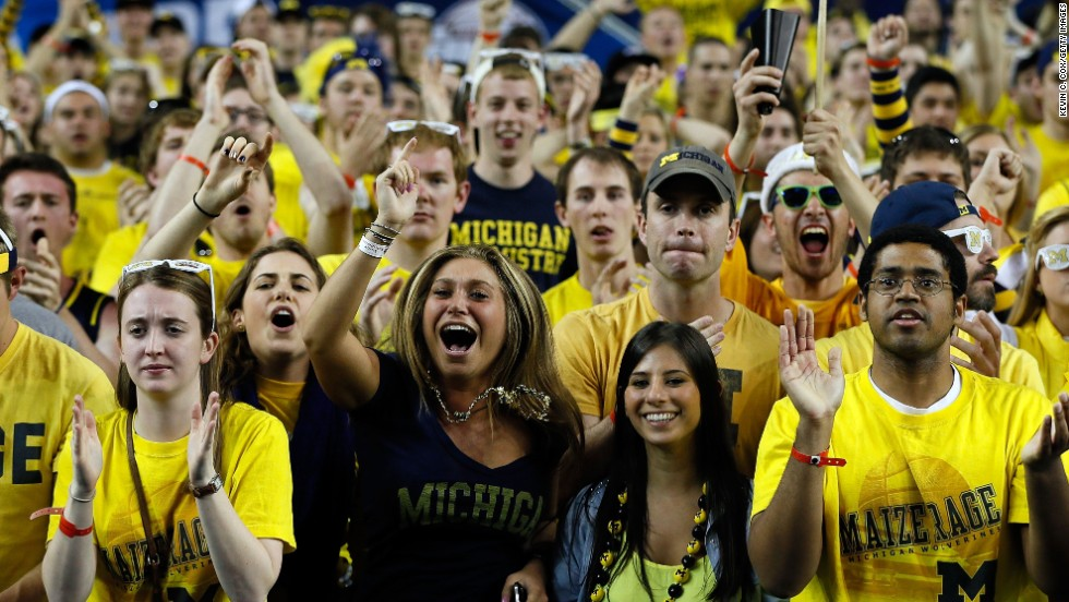 Fans of the Michigan Wolverines support their team in the first half against Syracuse.