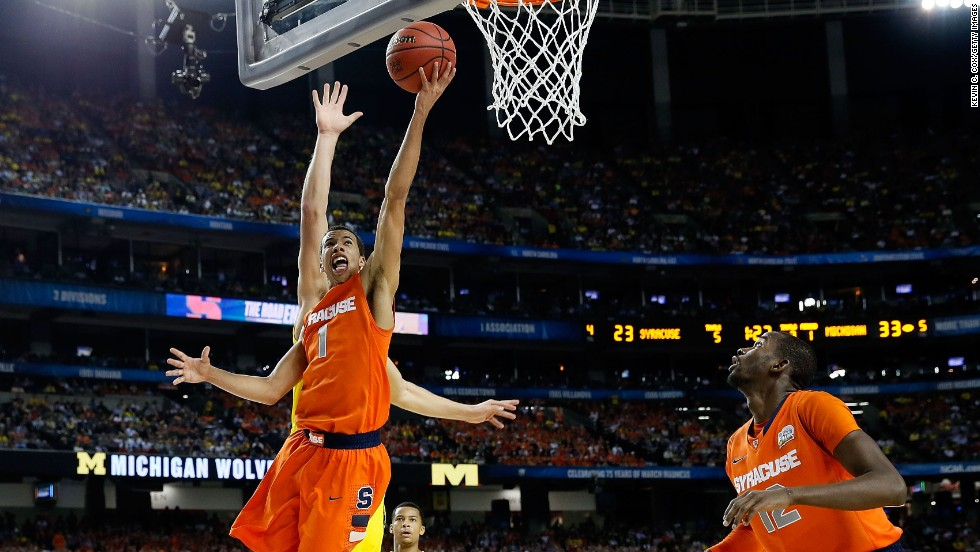 Michael Carter-Williams of the Syracuse Orange drives for a shot against the Michigan Wolverines.