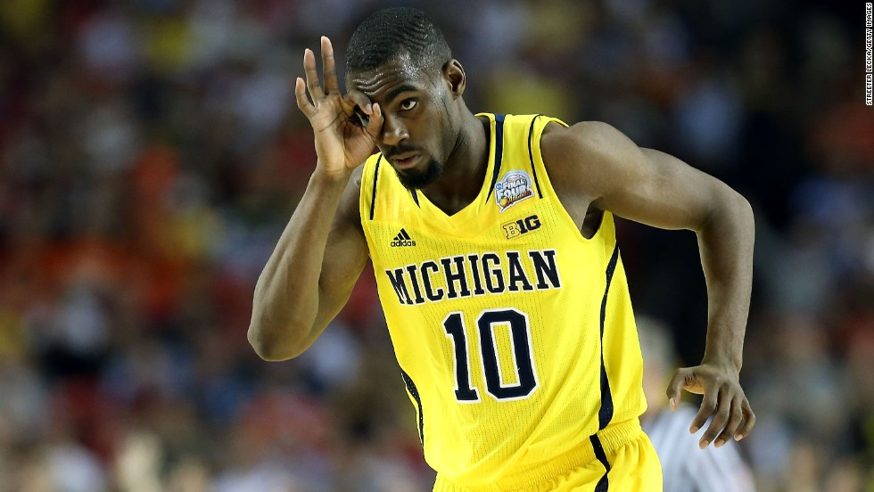 Tim Hardaway Jr. of Michigan reacts after making a 3-point shot.