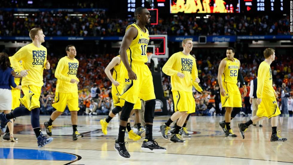 Michigan celebrates its victory over Syracuse.