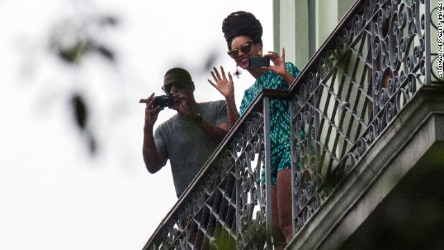 US singer Beyonce is seen in a balcony of the Saratoga Hotel in Havana next to her husband Jay Z, on April 5, 2013. Pop diva Beyonce and her rapper husband Jay-Z on Thursday created a stir as they toured the streets of Old Havana, with hundreds of Cubans turning out to catch a glimpse of the US power couple.   AFP PHOTO/STR        (Photo credit should read STR/AFP/Getty Images)
