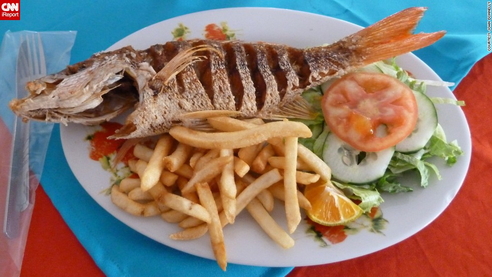 "<a href=""http://ireport.cnn.com/docs/DOC-943575"">John Donnelly</a> found his favorite dish in Costa Rica. He was at a Chinese restaurant called El Milenio. He describes the dish, pescado frito entero, as quite simple but delicious. The fish, with head and tail, are fried until everything is crispy on the outside and tender on the inside. ""It's a little bit of work to get the meat off the bone, but I think that's part of the fun,"" he said."