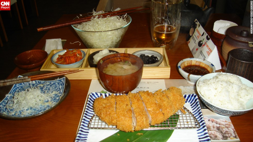 "<a href=""http://ireport.cnn.com/docs/DOC-944068"">Philip Atkinson </a>says he had one of the best Japanese dishes he's ever tasted in China. Tonkatsu is a boneless pork chop that is breaded in panko, deep-fried and served with a seasoned dipping sauce. He says this is his favorite travel dish because of the food and the service. ""Preparing food for another person is a very connecting experience when you think about it. That other person is taking the very act of nourishing you,"" he said."
