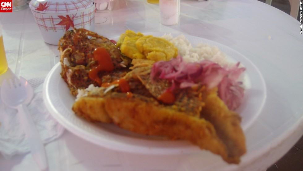 "While traveling through the Galapagos, <a href=""http://ireport.cnn.com/docs/DOC-944284"">Caroline Cheung</a> found a makeshift eatery in front of a fishing pier. She stopped there for lunch because she wanted to try the local eats. ""It was a whole fish that was previously marinated, then dipped in a batter and deep fried to crispy perfection,"" she said."