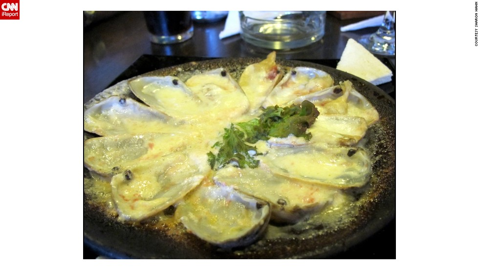 "While visiting her daughter in Valparaiso, Chile, <a href=""http://ireport.cnn.com/docs/DOC-946419"">Sharon Hahn</a> knew she had to try the razor clams. The dish is served as an appetizer. The clams are broiled on the half shell and topped with garlic, breadcrumbs and butter. ""You can get it all over Chile. It is a marisco, or shellfish, which is very popular in the country,"" she said."