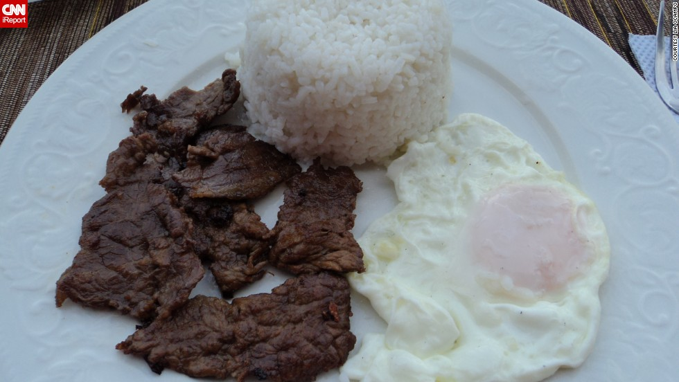 "<a href=""http://ireport.cnn.com/docs/DOC-950592"">Lia Ocampo</a> says her favorite nostalgic and tasty treat is fried beef from Batanes, Philippines. She says the dish, served up on a bed of freshly cooked white rice with a fried egg, is delicious and filling. ""A trip to Batanes is not complete if you don't have the chance to taste this,"" she said."
