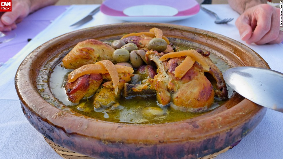"<a href=""http://ireport.cnn.com/docs/DOC-952107"">Gary Ashley</a> says his favorite dish, known commonly as Marrakech chicken, is served widely in Morocco. The dish consists of chicken that is slow-cooked in a stew, flavored with whole green olives, preserved lemons and Moroccan spices, and served with couscous."