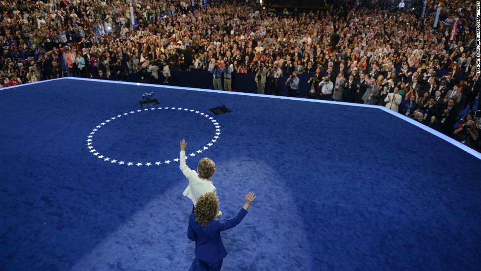 Wasserman Schultz, head of the Democratic National Committee,  and Giffords wave to the audience after Giffords delivered the Pledge of Allegiance on September 6, 2012, the final day of the Democratic National Convention in Charlotte, North Carolina.