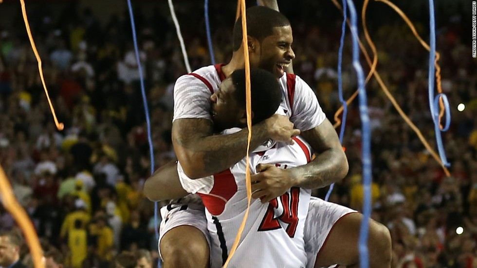 Chane Behanan, top, and Montrezl Harrell of Louisville celebrate.