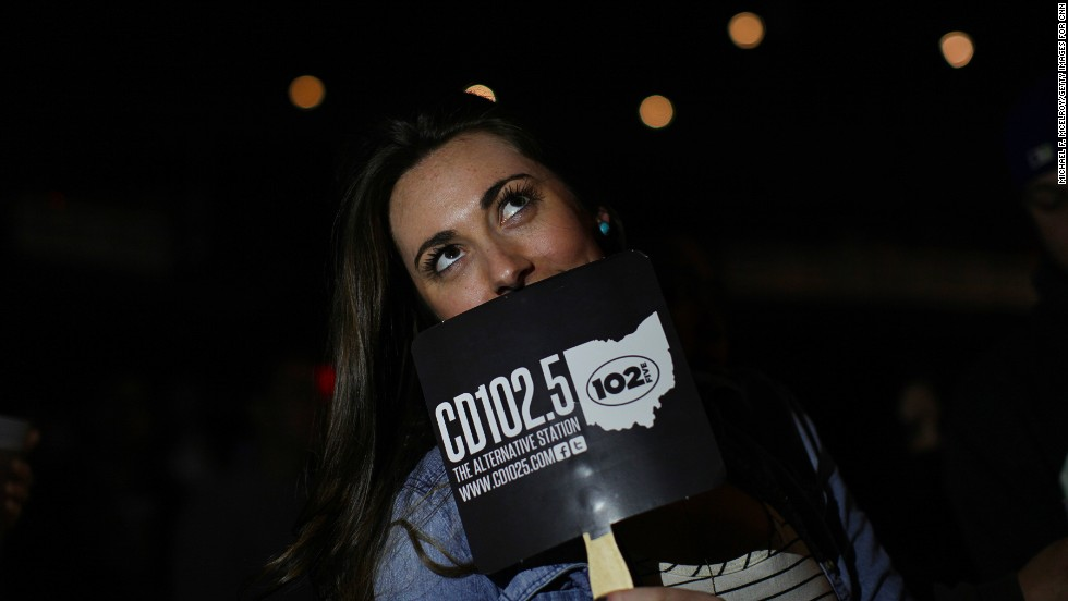 A concertgoer cools off with a CD102.5 fan. The station's staff members say they believe the community is behind them.