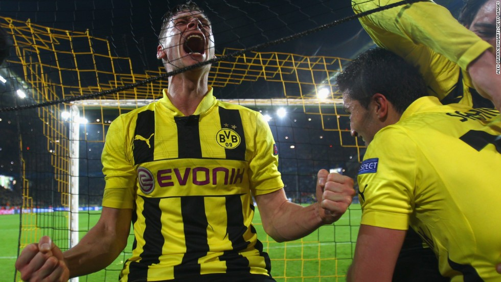 Lukasz Piszczek, Nuri Sahin and Mats Hummels can't help but go crazy with excitement following the final whistle.