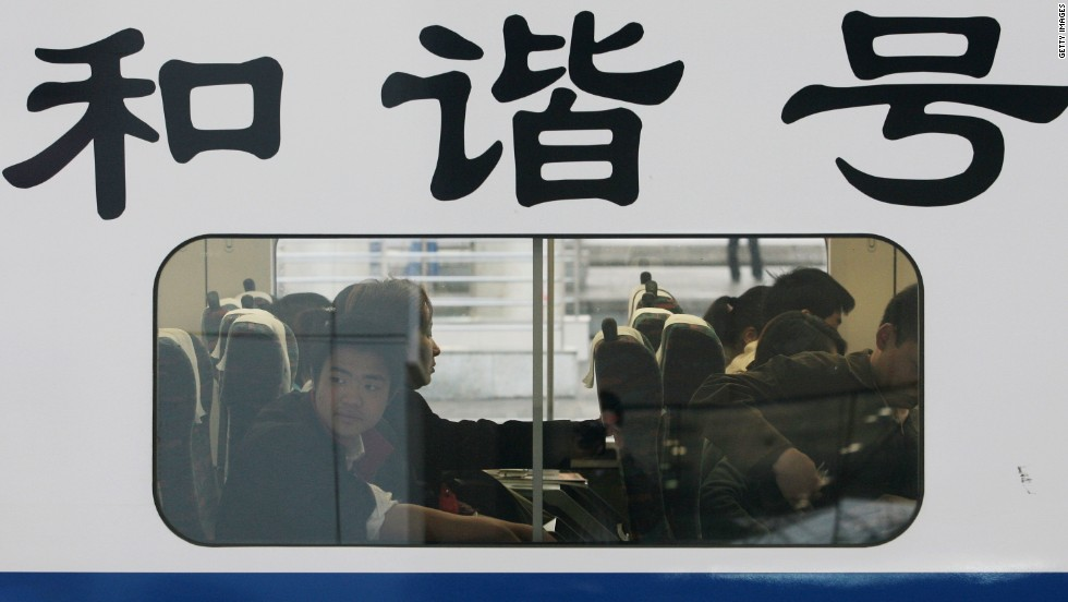 """Waiting on a train in Nanjing. The national railway operator runs high-speed locomotives marked """"The Harmony"""" in Chinese."""