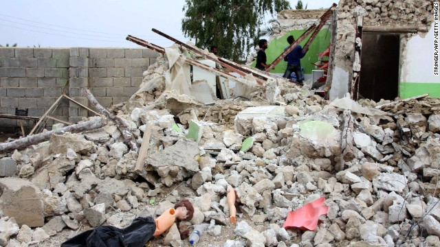 People inspect the damage of a destroyed house on April 10.