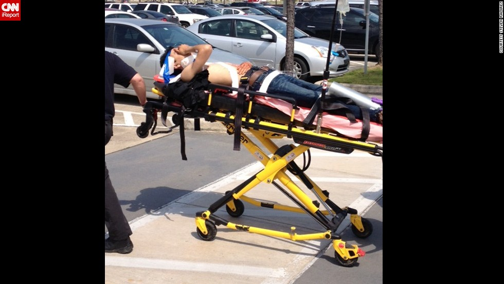 A victim is taken from the scene on a stretcher.