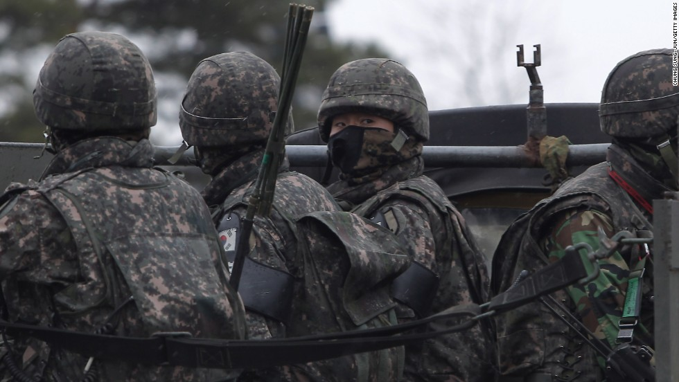 South Korean soldiers sit in a truck at the Inter-Korean transit office on Tuesday, April 9, in Paju, South Korea.