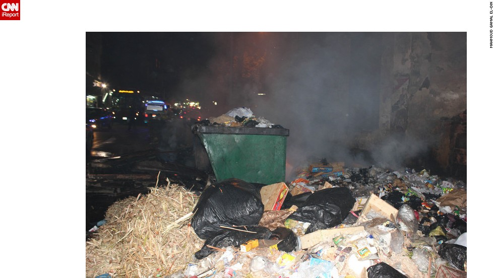 """Piles of uncollected garbage lay strewn over the walkways of Egypt's suburbs. <a href=""""http://ireport.cnn.com/docs/DOC-951997"""">Picture from iReporter Mahmoud Gamal El-Din</a>."""