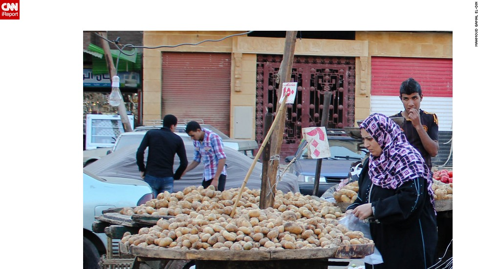 """A woman shops at a local market in <a href=""""http://www.cnn.com/2013/01/10/business/analysis-defterios-davos-egypt/index.html?iref=allsearch"""">Egypt where 40% of the population live on less than $2 a da</a>y. Picture from iReporter Mahmoud Gamal El-Din."""